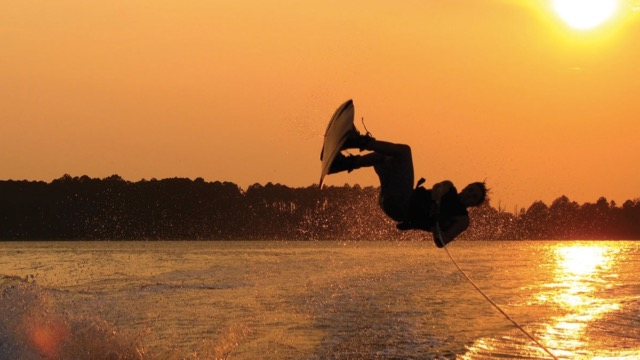 wake board rider in hilton head sunset boat trip